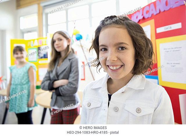Portrait of confident school girl at science fair