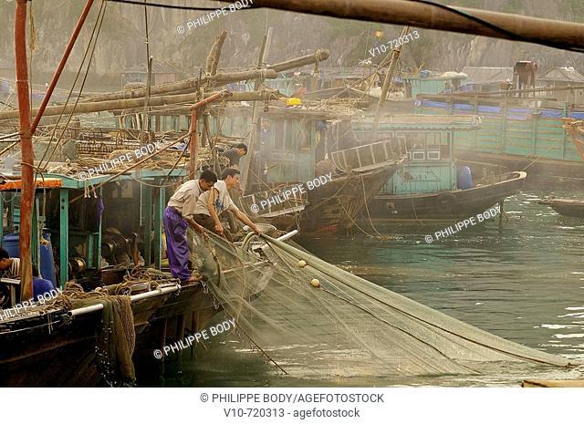 Fishermen cleaning their nets, Fishing port, Cai Rong, Ha Long Bay, Vietnam