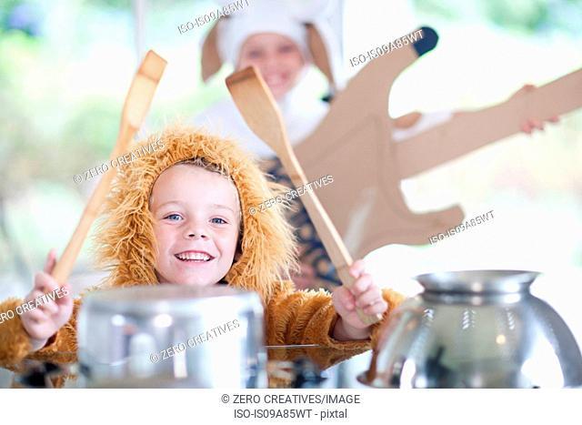 Children pretending to play music instruments