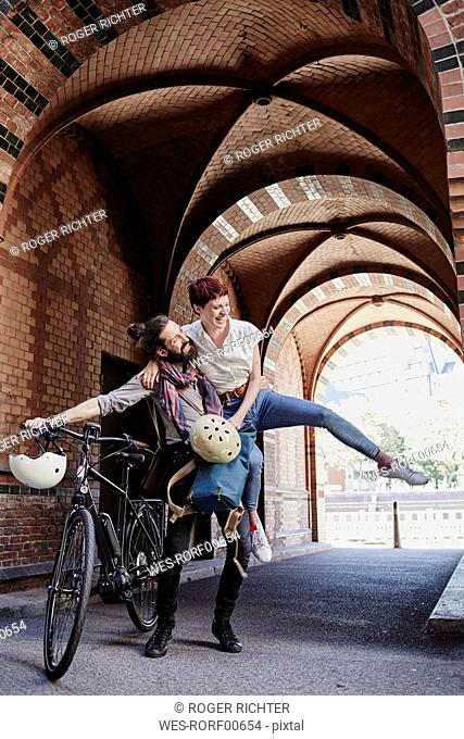 Happy couple with electric bicycle