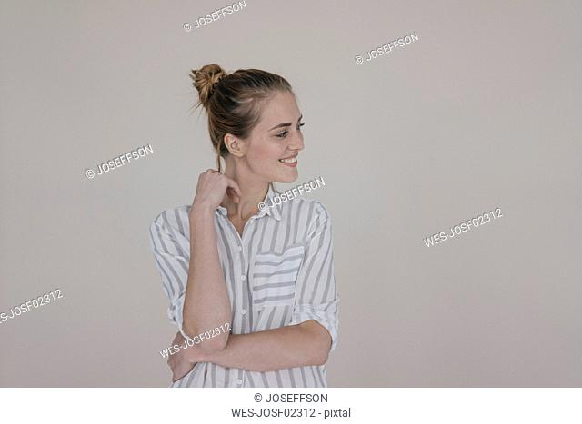 Portrait of a pretty woman, smiling, looking away