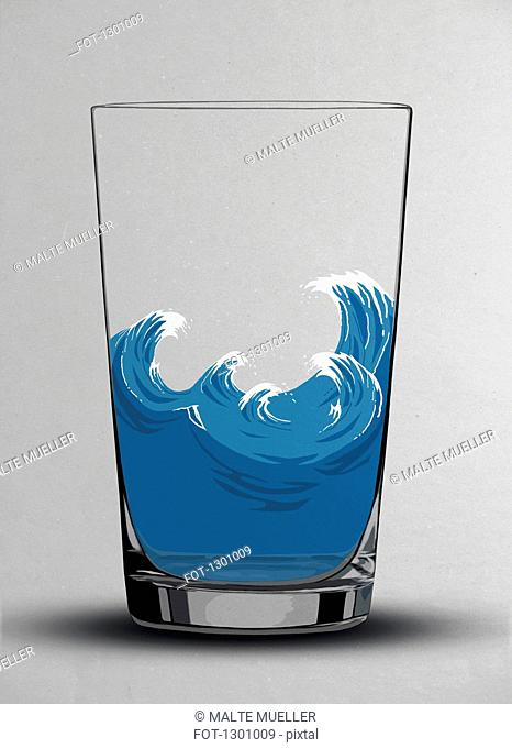 Illustration of choppy waves in a water glass