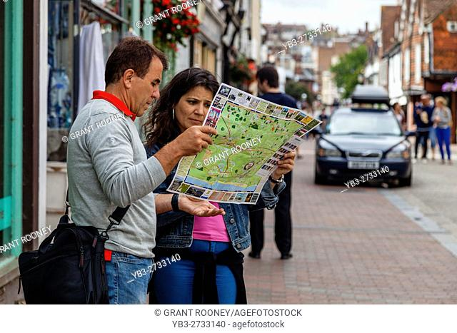 Two Tourists Looking At A Street Map, High Street, Lewes, Sussex, UK