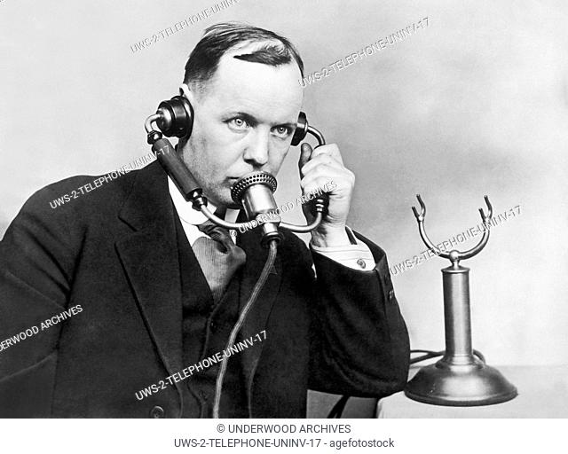 United States: January 16, 1928.Magnavox co-inventor E. S. Pridham demonstrates his anti noise telephone for use around machines, engines and airplanes