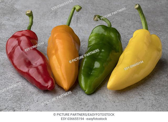 Fresh variety of red, yellow, orange and green sweet pointed peppers
