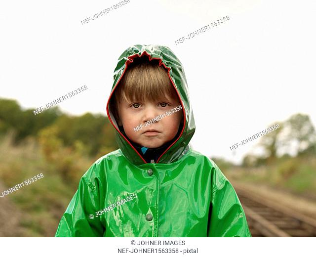 Portrait of boy wearing rain jacket