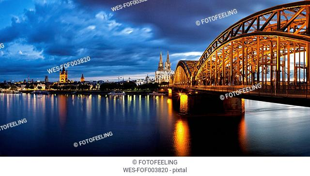 Germany, Cologne, View of Cologne Cathedral, Hohenzollern Bridge and Great Saint Martin Church with River Rhine
