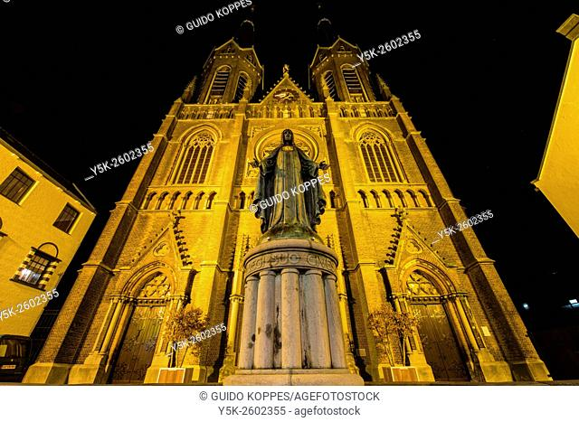 Tilburg, Netherlands. Night time view on the landmark, dual tower Catholic church, down town