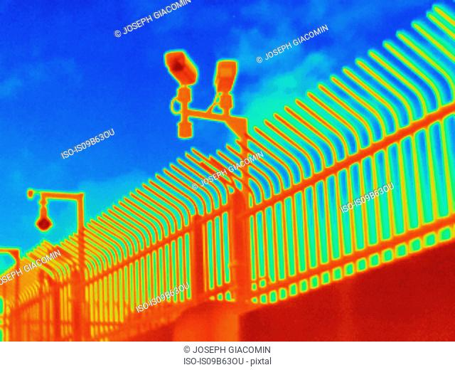 Thermal photograph of security cameras and fence