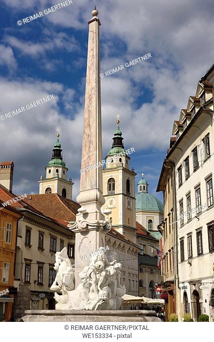 Robba Fountain of the Three Rivers in the Town Square of Ljubljana capitol city of Slovenia with St Nicholas Ljubljana Cathedral catholic church