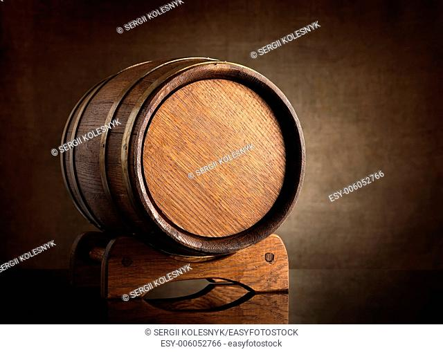 Old wooden barrel on a background of canvas