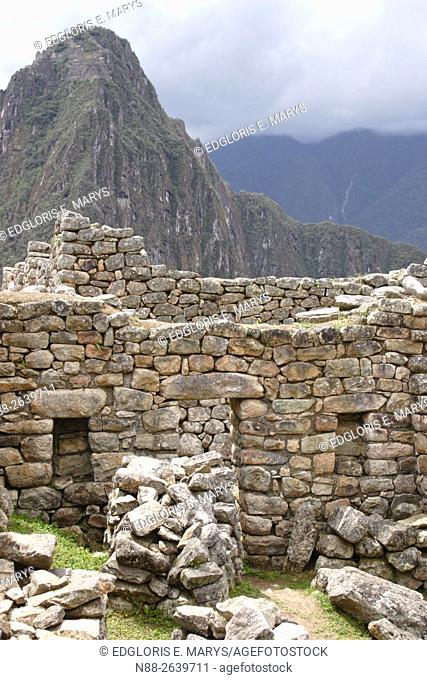 Detail of the ruins of Machu Picchu with a view of the mountain