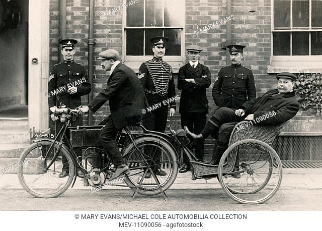 Group of uniformed gentlemen pose for a photograph with a 1903 'Experimental' Matchless motorcycle trailing a wicker one seater carriage/car circa 1903/4