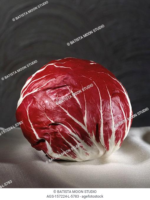 Agriculture - Whole head of radicchio on a white tablecloth, studio