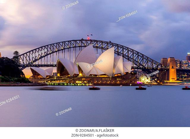 View on Sydney opera and Harbour bridge in purple sunset, long exposure