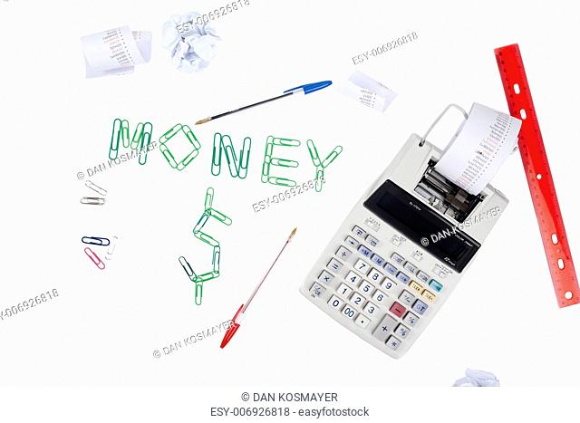 Scattered receipt, pen, ruler, calculator and money word over a white background