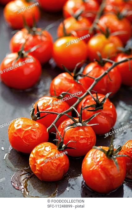 Oven-roasted cherry tomatoes on the baking tray