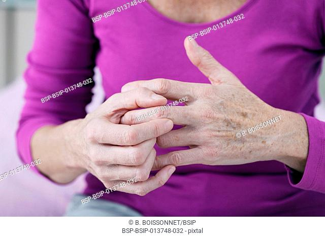 Elderly person with painful hand