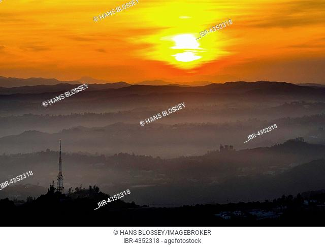 Sunset over Hollywood Hills with transmission tower, Los Angeles, Los Angeles County, California, USA
