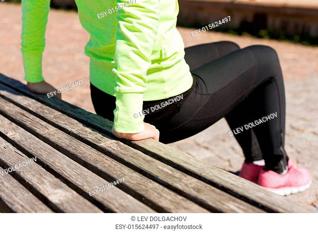 sport, fitness, exercise and lifestyle concept - woman doing sports outdoors