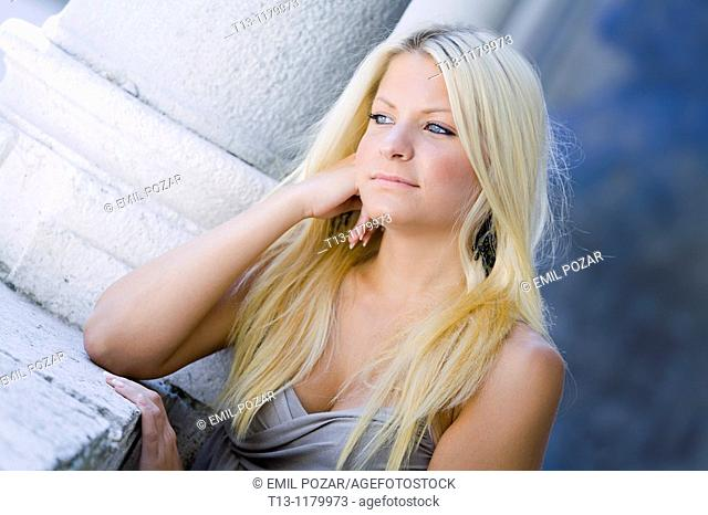 Daydreaming young woman with beautiful Blue eyes