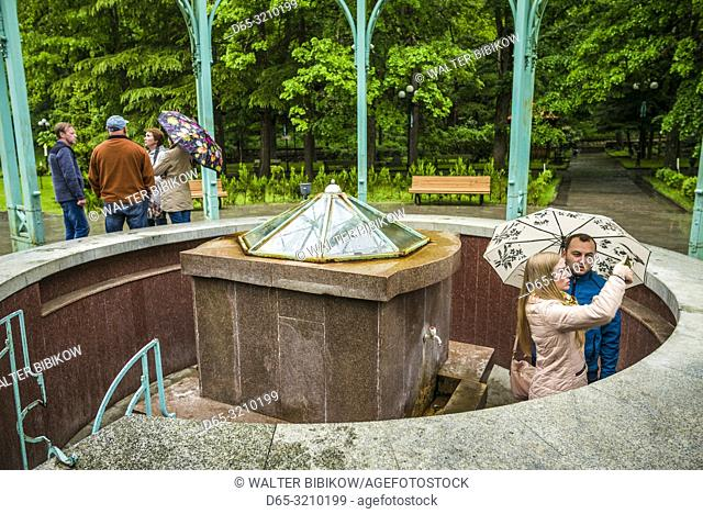 Georgia, Borjomi, famous mineral water resort, sampling the waters at the Ekaterina Spring, NR