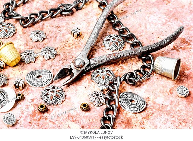 Stylish female jewelry made of chains, beads and pendants.Design and bijouterie