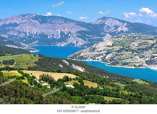 Lake of Serre-Poncon (Alpes-de-Haute-Provence, Provence-Alpes-Cote-d'Azur, france): mountain landscape in the French Alps at june