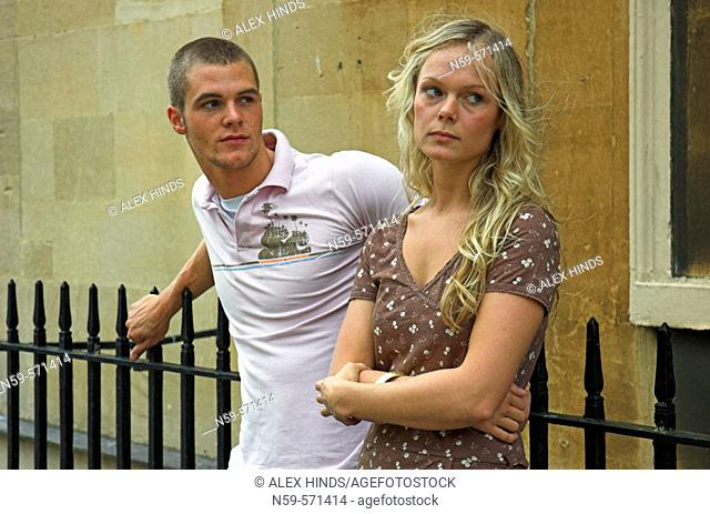 Attractive young couple with relationship problems and struggling to communicate