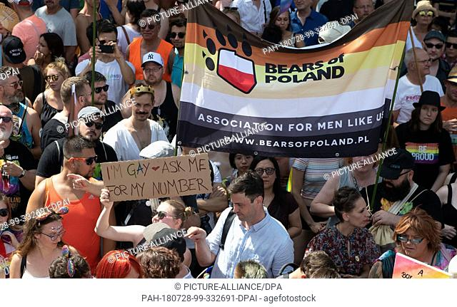 """28 July 2018, Germany, Berlin: Participants of the parade for Christopher Street Day (CSD) fly the flag of the Polish """"""""Bear Community"""""""""""