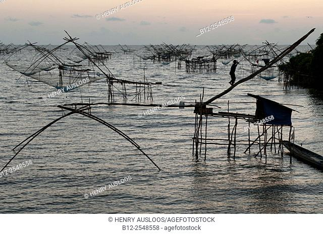 Shore-operated lift net, Before sunrise, Fisherman, Phatthalung, Southern Thailand
