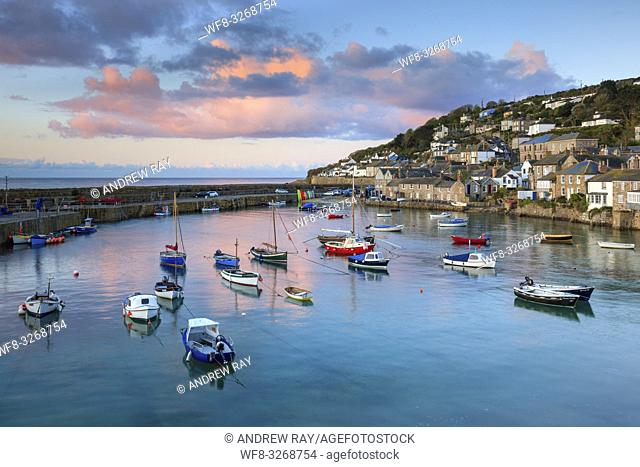 The picturesque harbour at Mousehole on the western side of Mount's Bay in Cornwall. The image was captured at sunrise on a still morning in late April