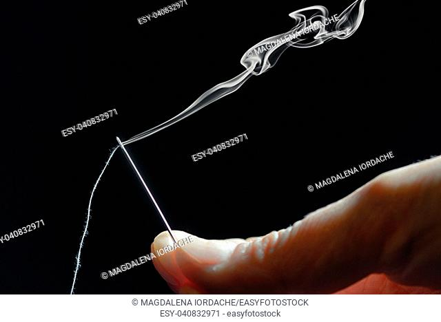 Abstract sewing needle and smoke