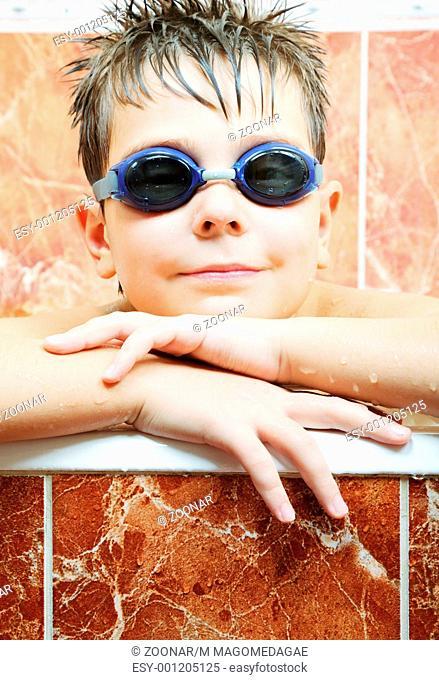 Cute boy in swimming goggles