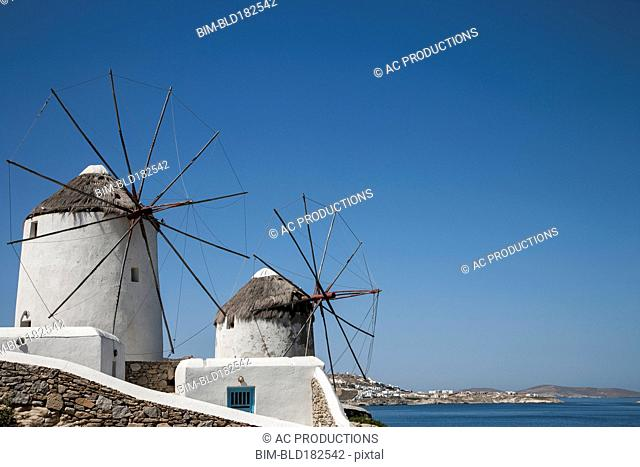 Traditional windmills under blue sky