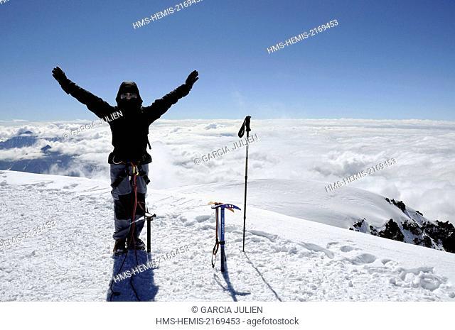 Georgia, Greater Caucasus, Mtskheta-Mtianeti, Mount Kazbek, happy mountaineer on the summit of Mount Kazbek (5047m)
