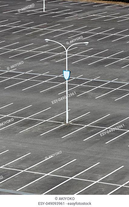 Car parking lot with white mark, light pole