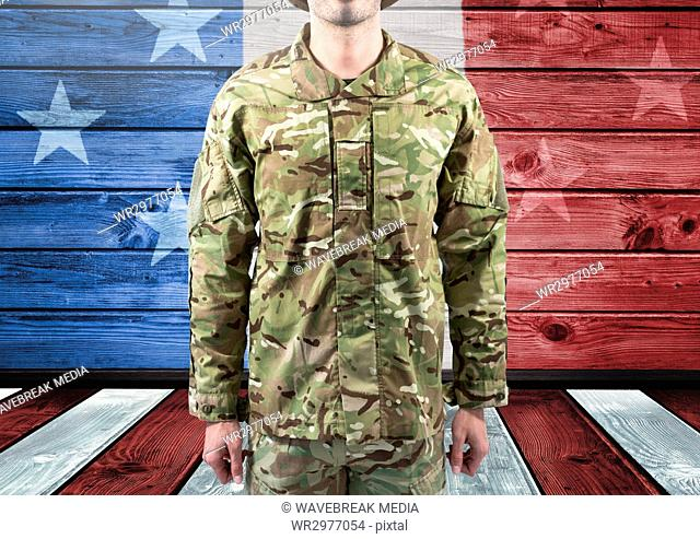 Military standing against american flag