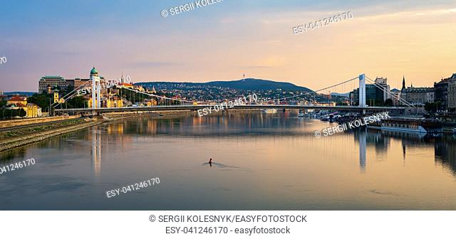 View on Elizabeth bridge and Budavari palace on Danube in Budapest at sunset