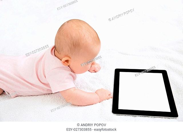 Happy Baby Looking At Digital Tablet While Lying On Bed