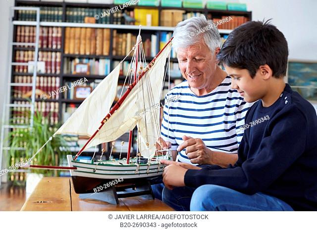 Grandfather and grandson, Building model sailboat, Whaleship, Getaria, Gipuzkoa, Basque Country, Spain, Europe