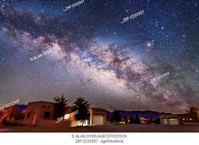 The summer Milky Way and centre of the Galaxy area in Scorpius and Sagittarius rising above the adobe lodges at the Painted Pony Resort in southwest New Mexico