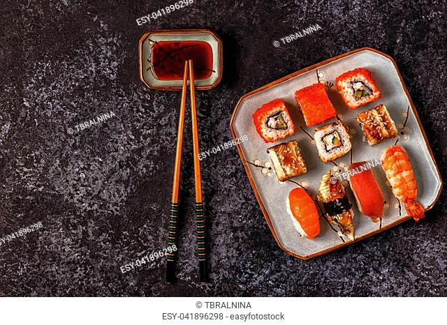 Sushi Set: sushi and sushi rolls on plate, top view