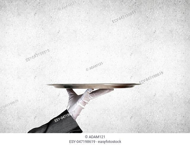 Waiter hand in white glove presenting empty tray