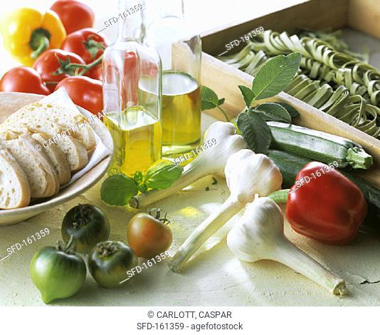 Still life: Mediterranean vegetables, bread, olive oil, pasta