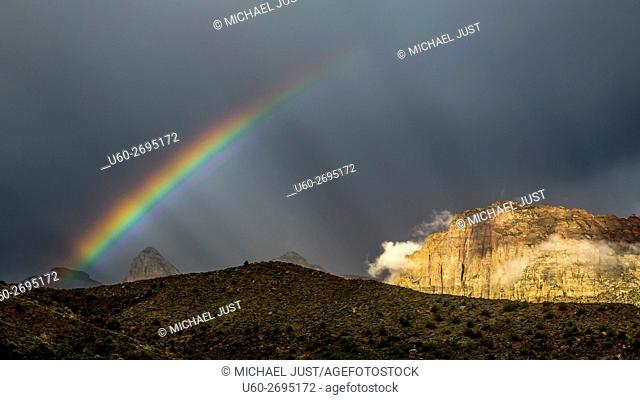 A passing thunderstorm produces a rainbow at Zion National Park, Utah