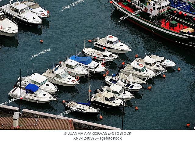 Small pleasure boats moored in the port of Elanchove on the coast of Vizcaya, Spain