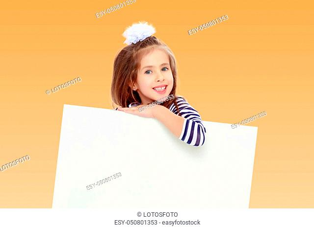 The little blonde girl with long hair and with a white bow on her head, in a blue striped summer dress. She peeks out from behind white banner