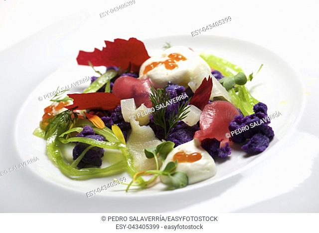 Russian salad on a white plate