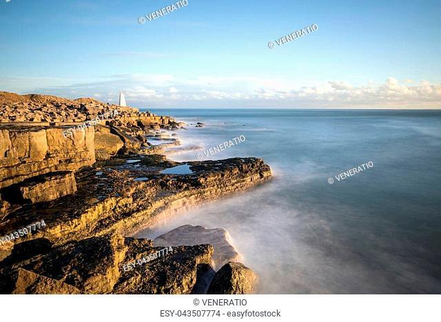 Beautiful sunset landscape image of Portland Bill rocks in Dorset England